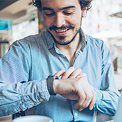 man checking watch for time