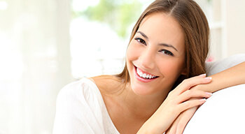 woman in white smiling bright