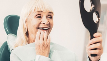 Woman looking at denture