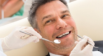 Smiling man in the dental chair