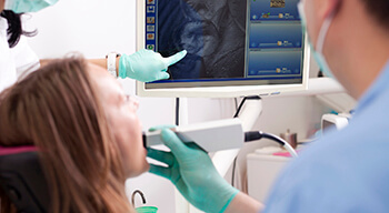 dentist using intraoral camera