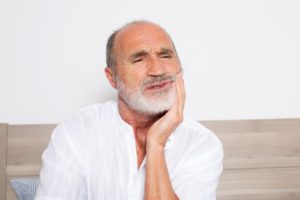 an older man experiencing gum pain