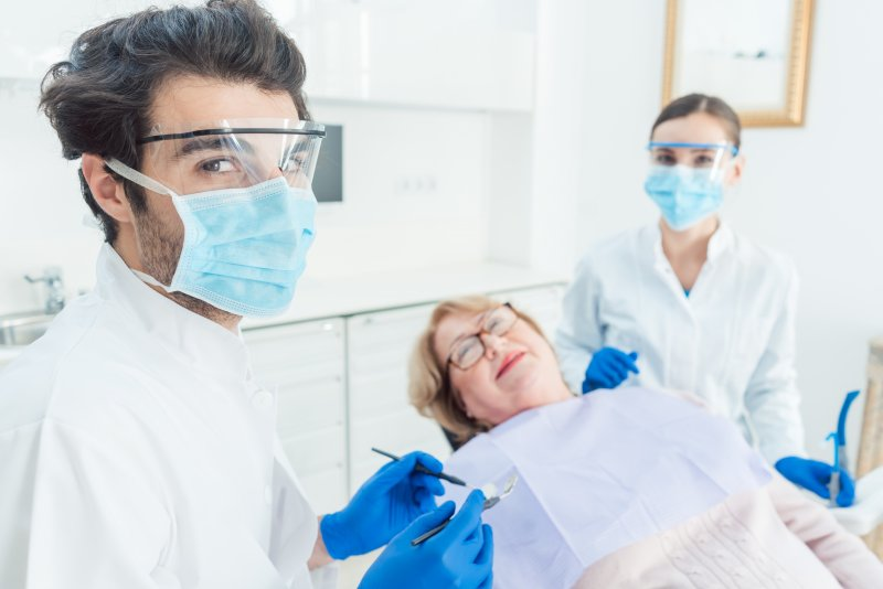 Dentist in Somerville, NJ wearing PPE with patient